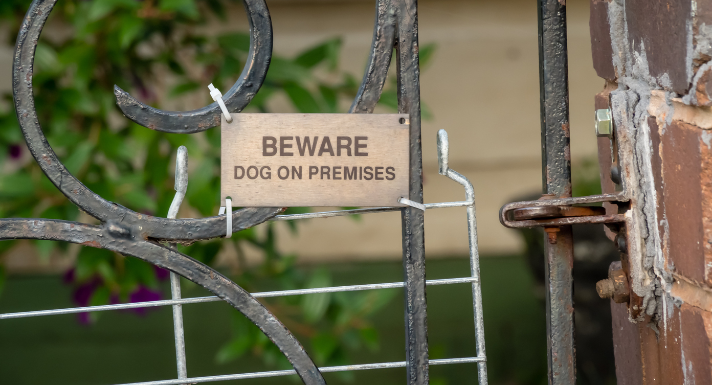 beware of dog sign on property
