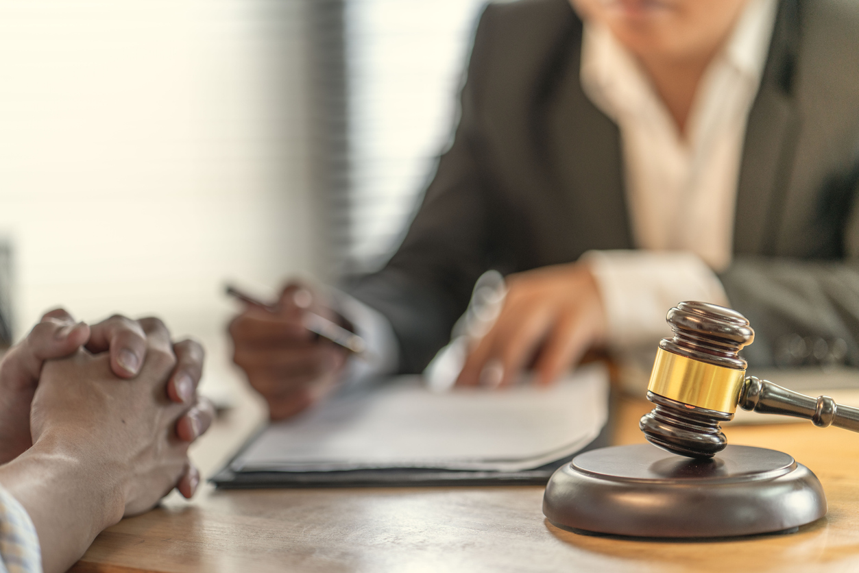 attorney and client discussing wrongful death lawsuit