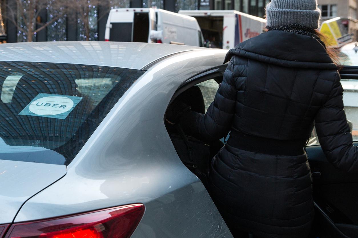 woman entering an uber
